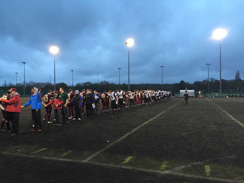 Game Over: The teams show respect to one another after a long battle lasting over two hours