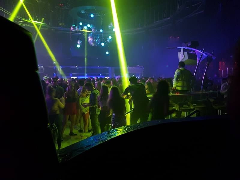 Image may contain: Night Life, Night Club, Festival, Club, Human, Person, People