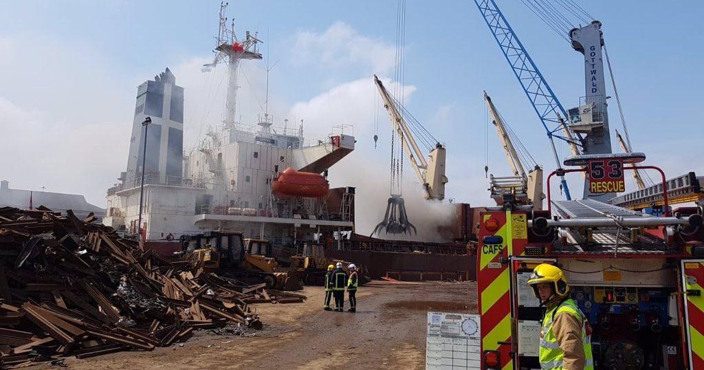 Image may contain: Constriction Crane, Person, Human, Fireman