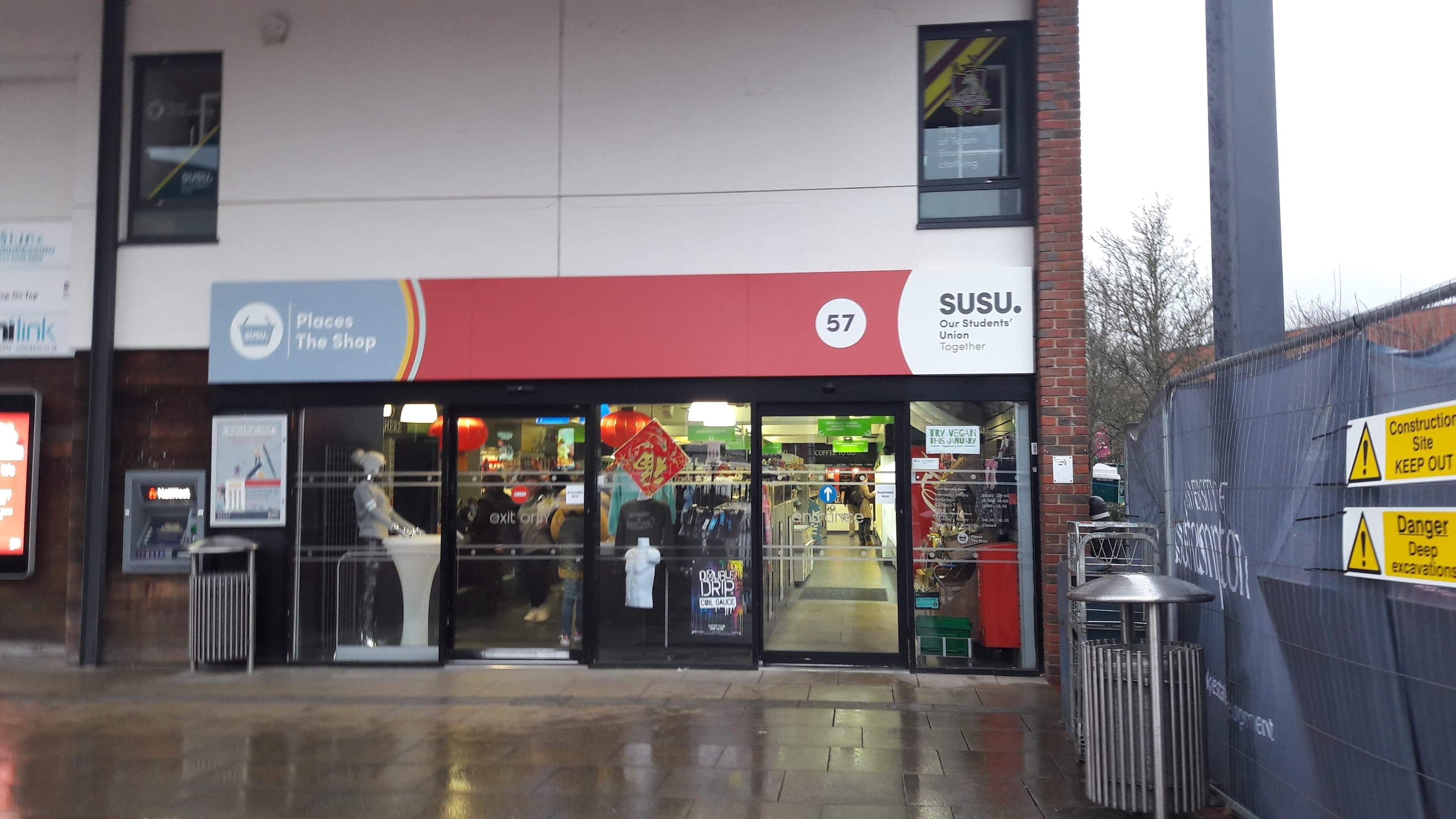 Image may contain: Kiosk, Shop, Human, Person