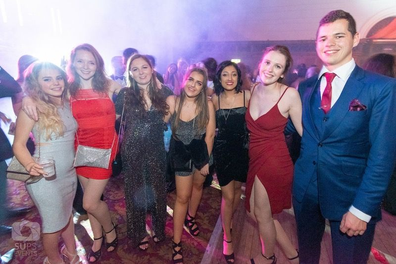Image may contain: Night Life, Suit, Overcoat, Coat, Shorts, Female, Dress, Apparel, Clothing, Party, Night Club, Club, Human, Person, Tie, Accessory, Accessories