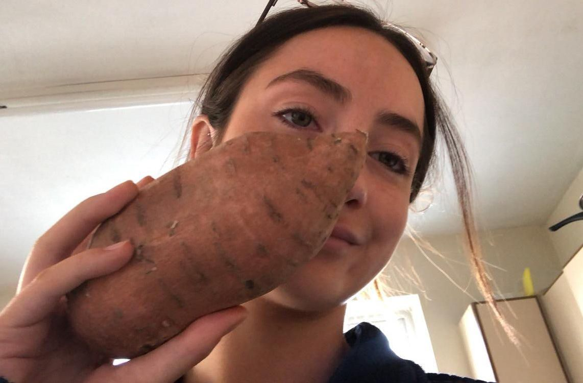 Image may contain: Sweet Potato, Produce, Yam, Vegetable, Food, Face, Person, Human, Plant