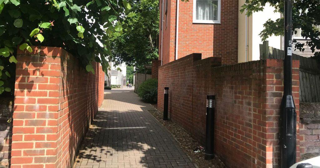 Image may contain: Cobblestone, Person, Human, Slate, Flagstone, Sidewalk, Pavement, Brick, Walkway, Path