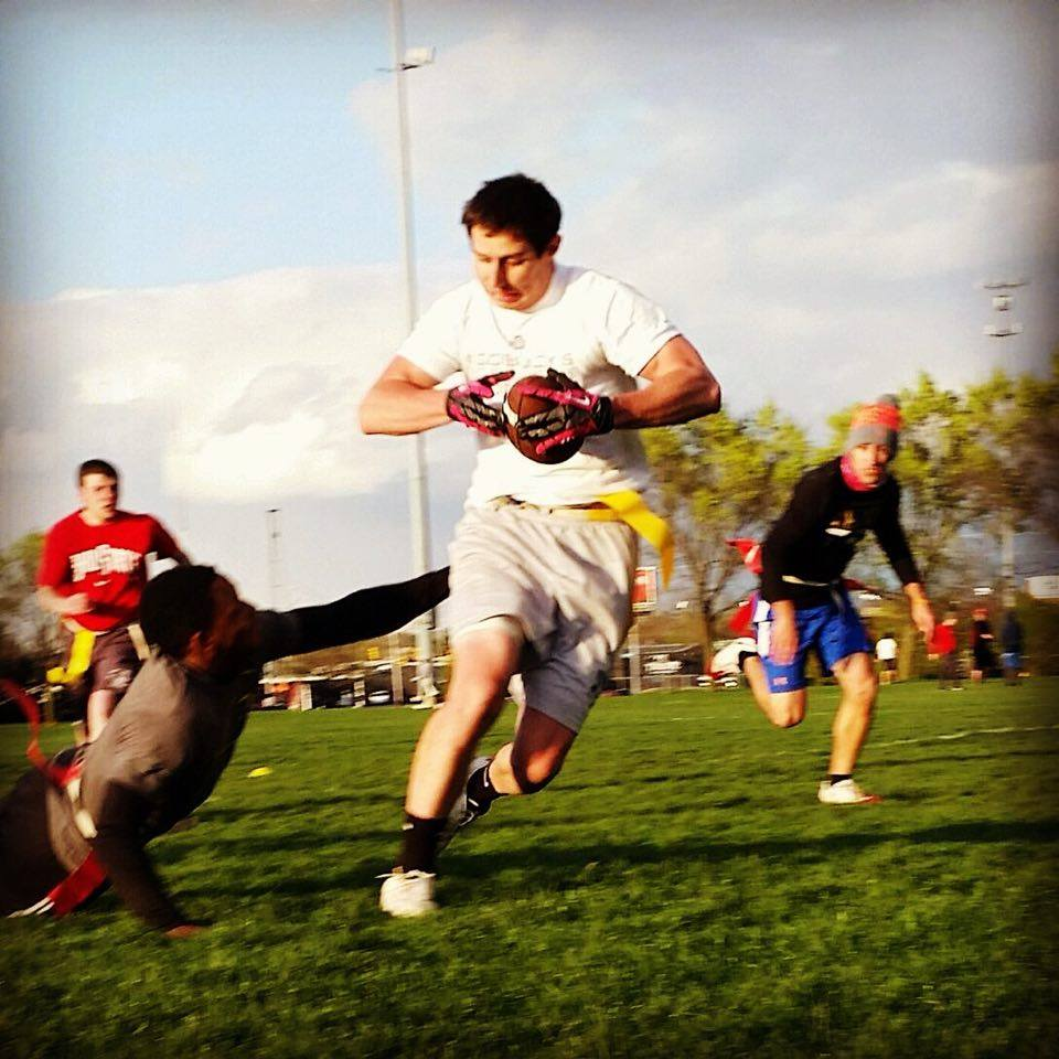 A man avoids a tackle in flag football