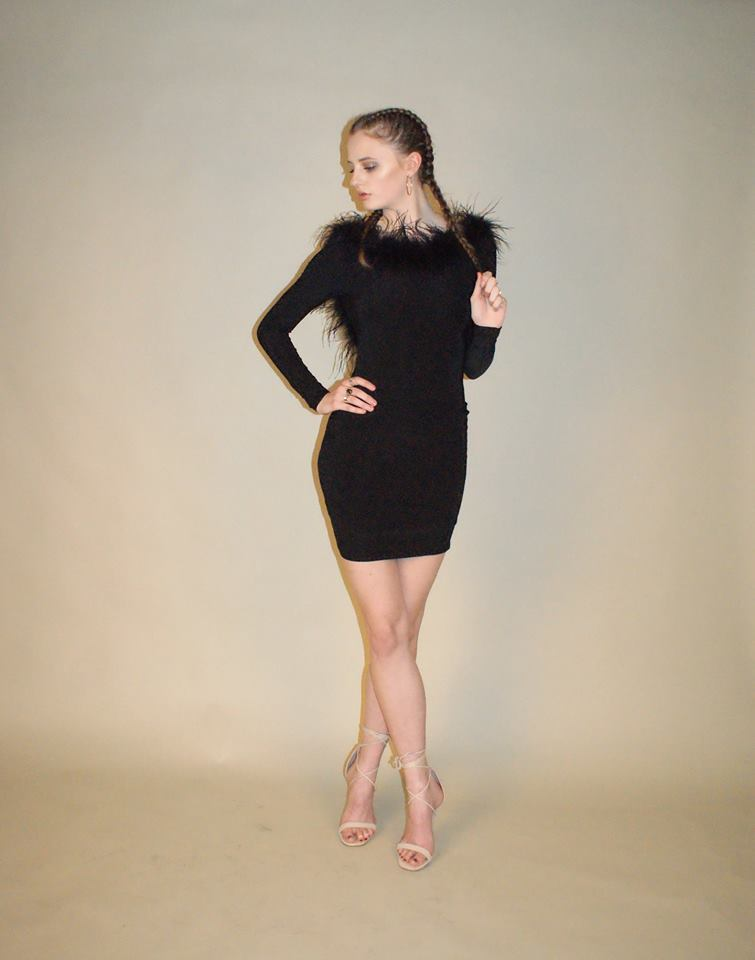 The little black dress with a sassy, fluffy twist