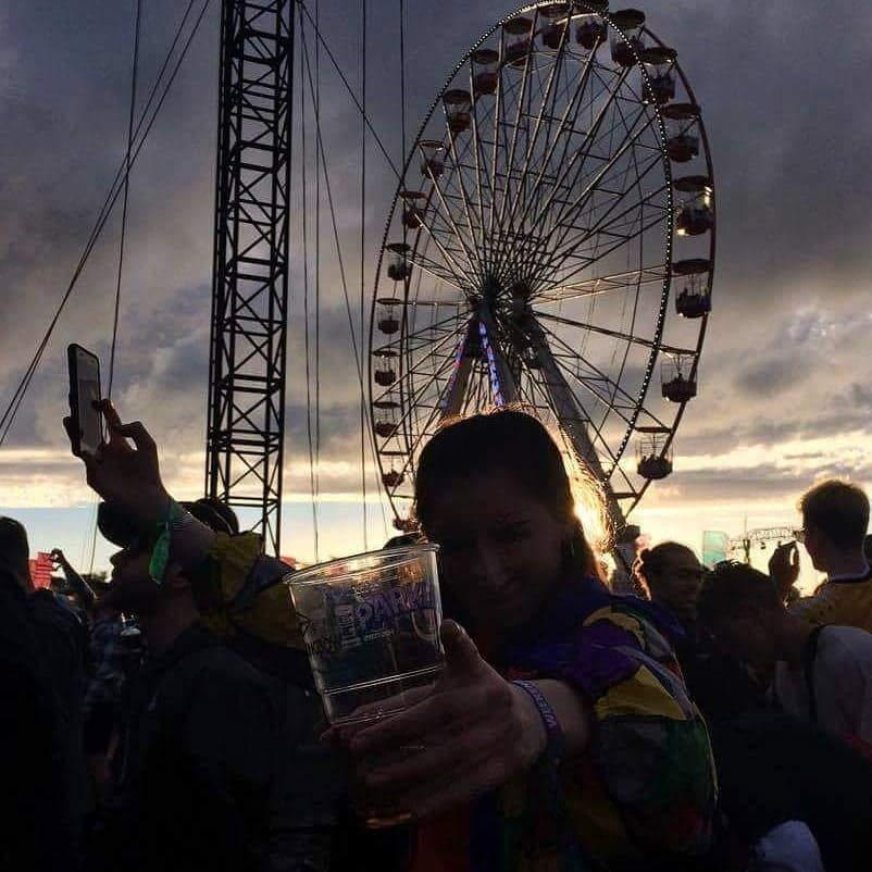 Image may contain: Make Out, Leisure Activities, Ferris Wheel, Crowd, Amusement Park, Person, People, Human