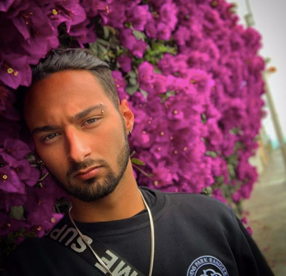 Image may contain: Purple, Portrait, Photo, Photography, Petal, Man, Flower, Blossom, Plant, Person, Human, Face