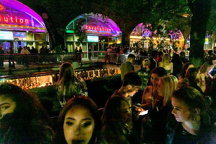 Image may contain: Food Court, Food, Outdoors, Bar Counter, Pub, Crowd, Restaurant, Person, Human, Lighting, Night Life