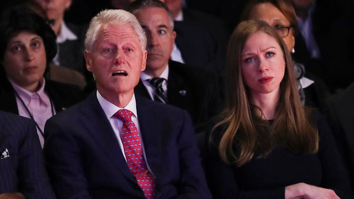 Former President Bill Clinton and Chelsea Clinton, daughter of Hillary Clinton listen during the presidential debate between Republican presidential nominee Donald Trump and Democratic presidential nominee Hillary Clinton at Hofstra University in Hempstead, N.Y., Monday, Sept. 26, 2016. (Joe Raedle/Pool via AP)