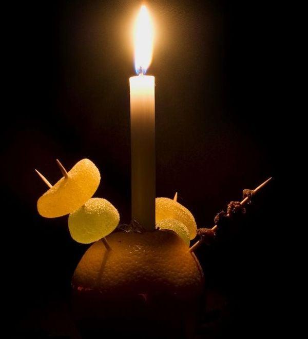 Image may contain: Candle, Produce, Plant, Orange, Grapefruit, Fruit, Food, Flora, Citrus Fruit