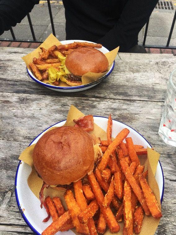 Image may contain: Plant, Dish, Meal, Burger, Food, Fries, Person, Human