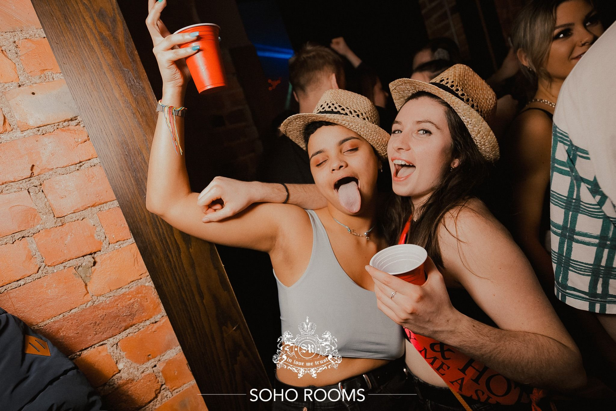 Image may contain: Finger, Night Life, Skin, Hat, Human, Person, Apparel, Clothing