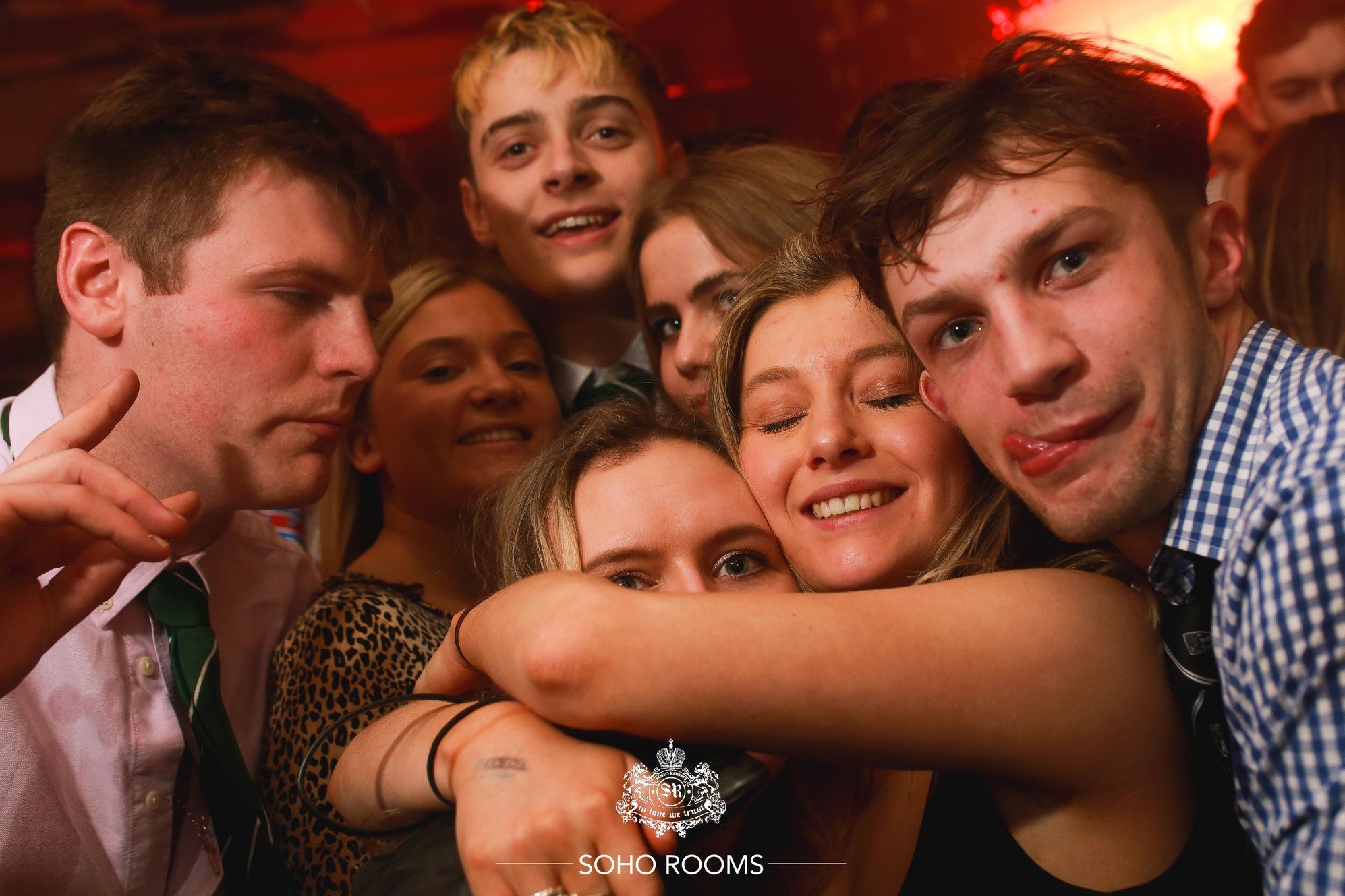 Image may contain: Party, Finger, Night Life, Night Club, Club, Person, Human