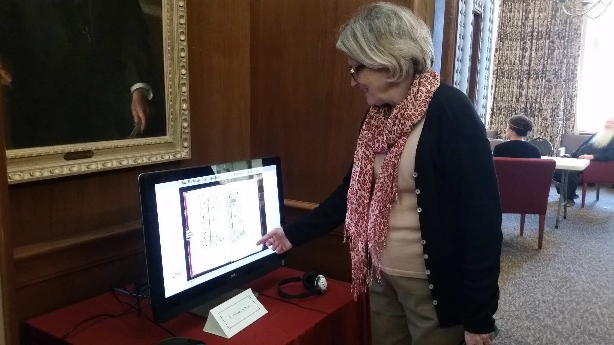 Cherry Williams, curator of manuscripts at the Lilly Library, pages through a digital version of a manuscript.