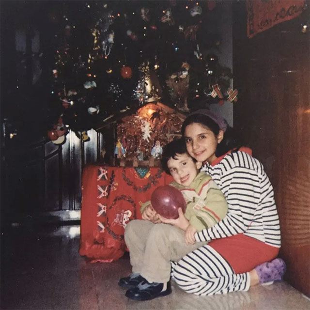 Mario and I hug in front of our Christmas tree at home in 2008