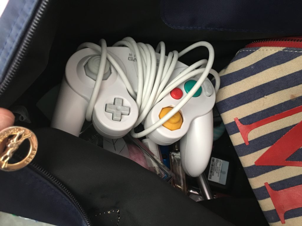 Casual Gamecube controller chilling in my purse because you never know when you need to play some Super Smash Brothers Melee