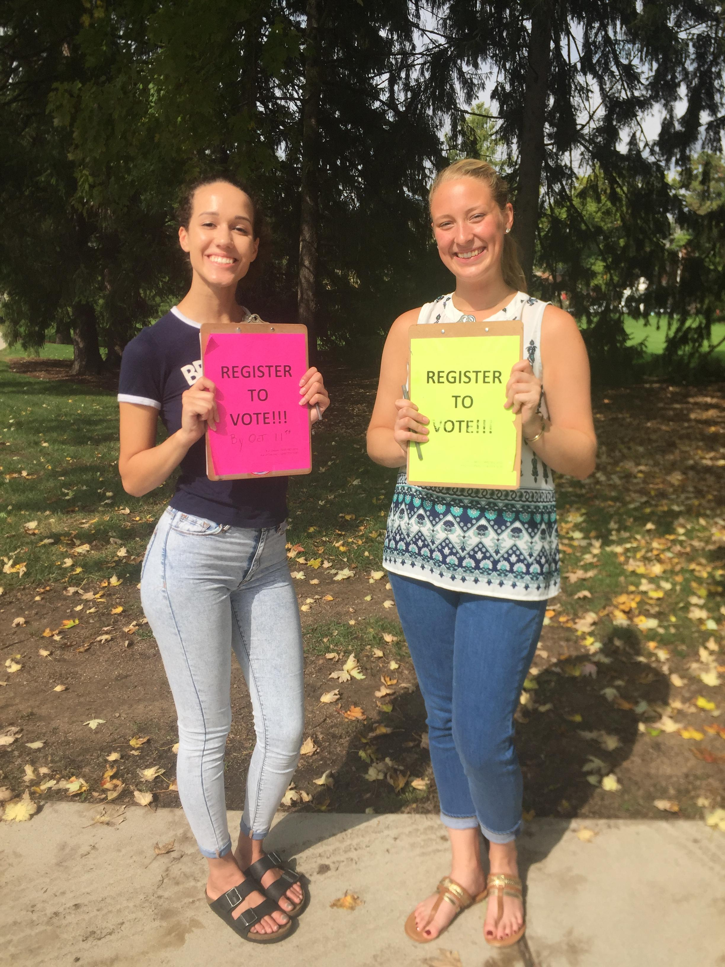 College students encouraging their peers to register to vote