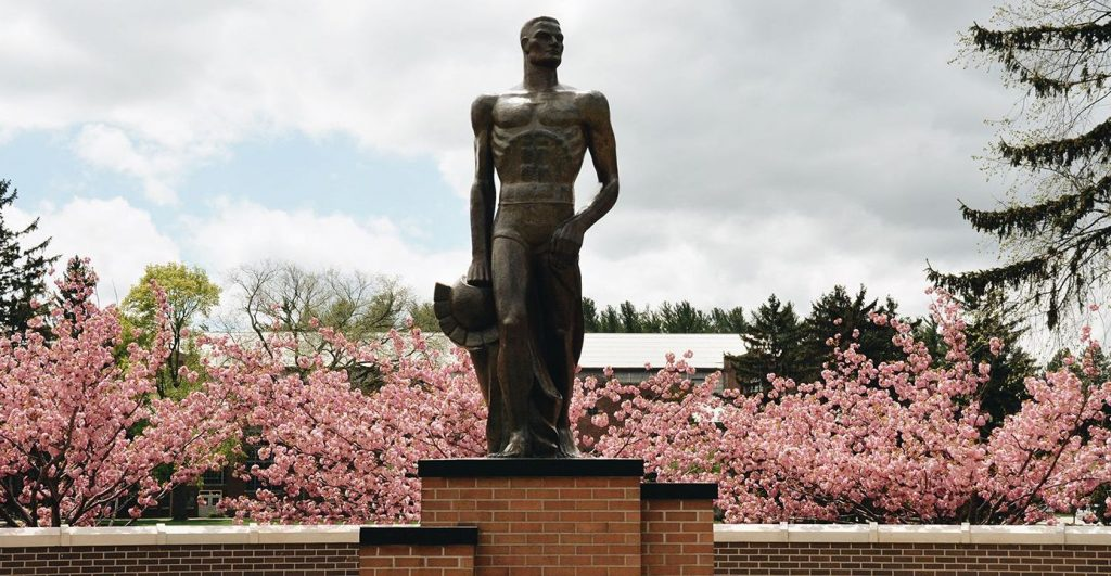 Image may contain: Statue, Monument, Cherry Blossom, Sculpture, Art, Plant, Flower, Flora, Blossom, Person, People, Human