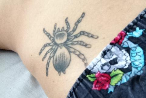 Tariq Moore's Spiderman themed tattoo represents his love of Marval and comics, a key part of his life.