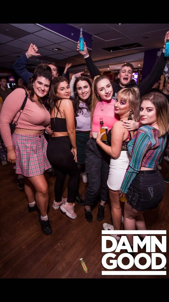 Image may contain: People, Skirt, Face, Female, Night Club, Club, Footwear, Shoe, Clothing, Apparel, Party, Human, Person