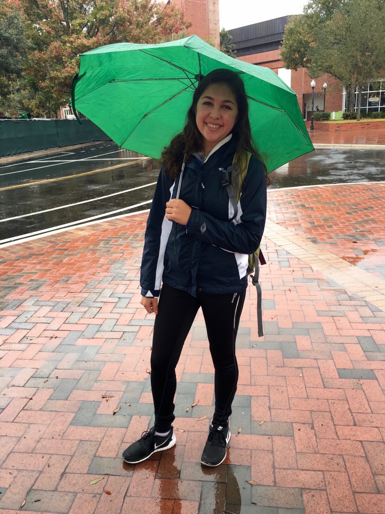 """She called it the """"just waking up"""" look, but she is sporting the most popular rainy trend at UF: rain jacket and athletic wear complimented by her cute umbrella."""