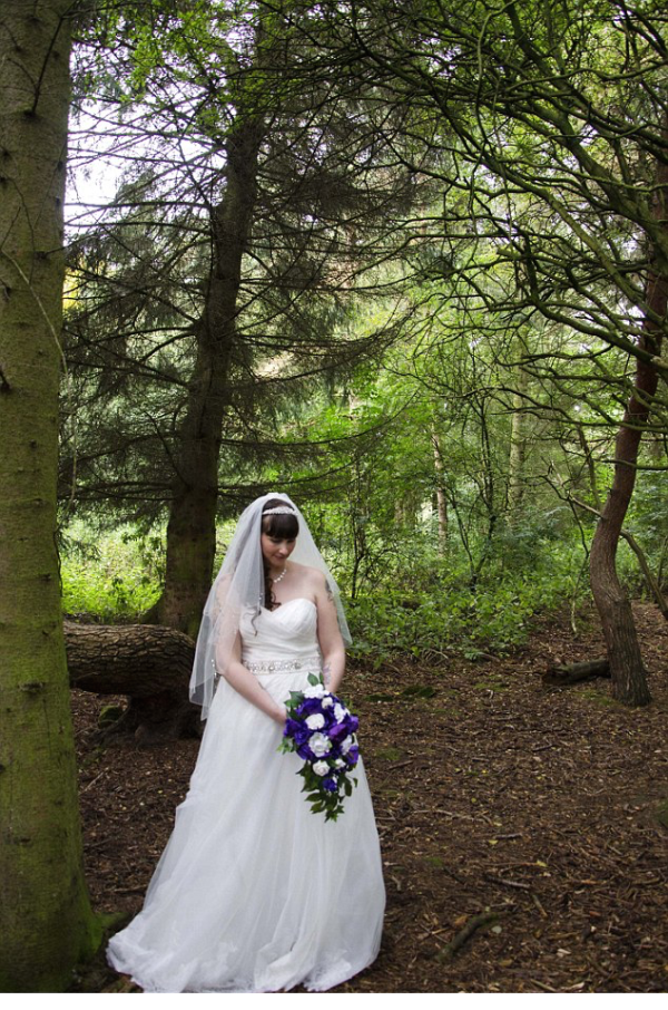 The couple claim setting up this photo ruined the bride's dress