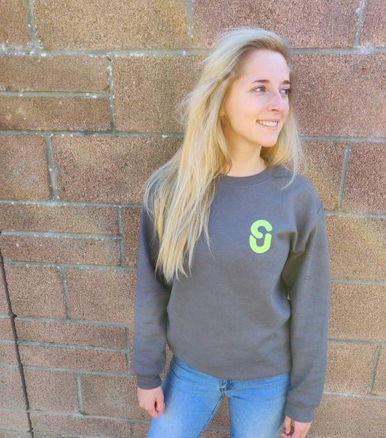 Image may contain: Brick, Sweater, Sweatshirt, Denim, Jeans, Pants, Blonde, Woman, Kid, Teen, Female, Person, Child, Girl, Human, Long Sleeve, Sleeve, Apparel, Clothing