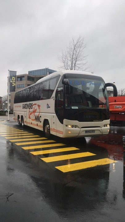 Image may contain: Zebra Crossing, Road, Asphalt, Tarmac, Vehicle, Transportation, Bus