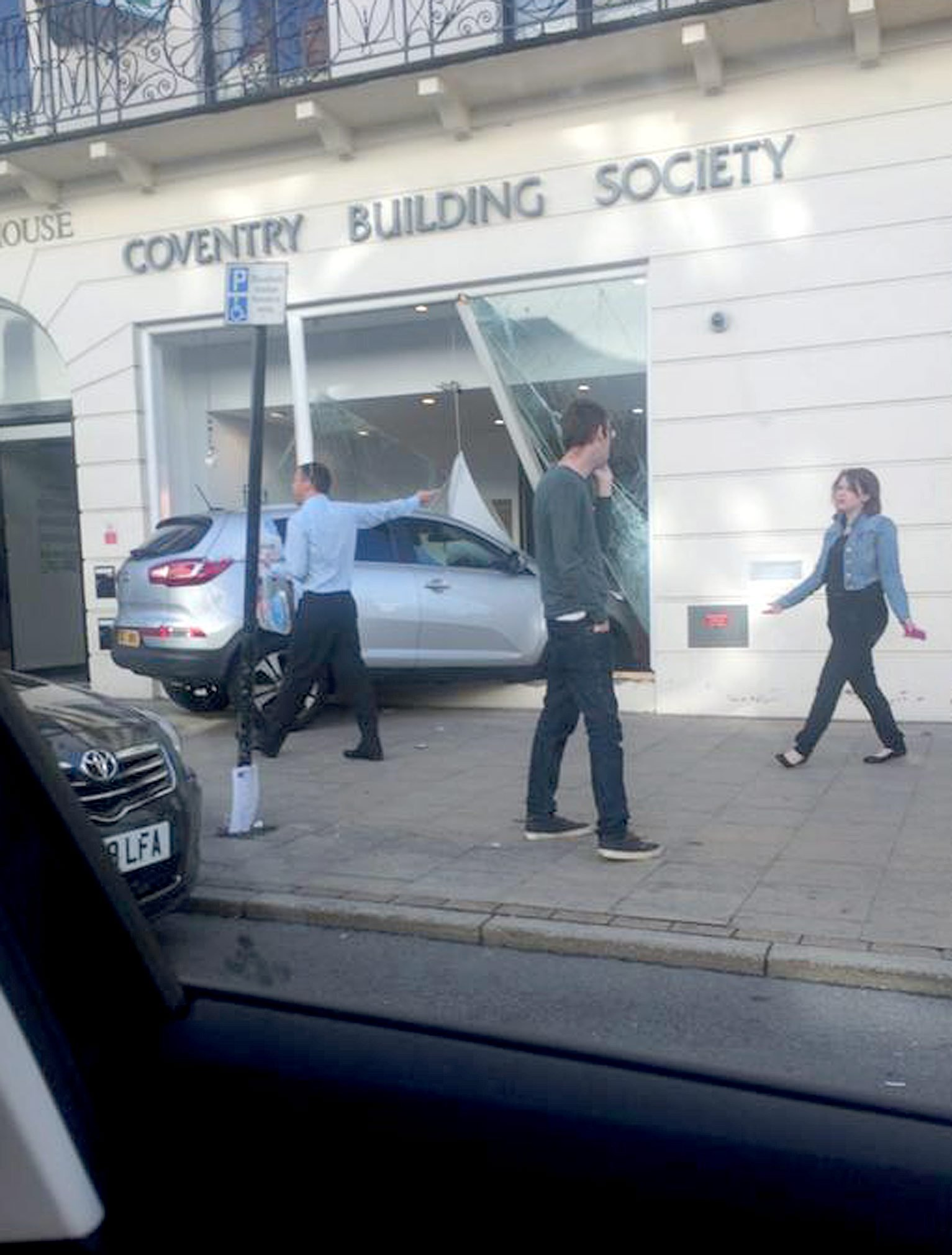 """A car crashed through the window of Coventry Building SocietyÃs, Leamington town centre branch this morning.  See NTI story NTIROBBERY.  The incident happened shortly before 9am this morning as commuters made their way to work in the busy Leamington town centre.  A grey Kia smashed through the front window of the building societyÃs upper Parade branch.  Warwickshire Police are at the scene, but nobody has been arrested and it is not yet known if anyone has been injured.  A spokesman for Warwickshire Police said: """"We were called just after 8.30am to reports of a robbery at Coventry Building Society on the Parade, in Leamington Spa.  Officers are currently at the scene dealing with the incident."""""""