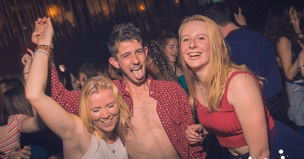 Image may contain: Disco, Night Life, Face, Night Club, Club, Party, Human, Person