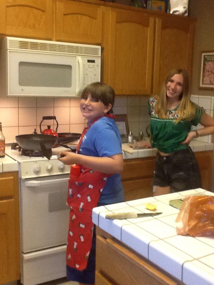 Teaching the little bro the ways of the kitchen.