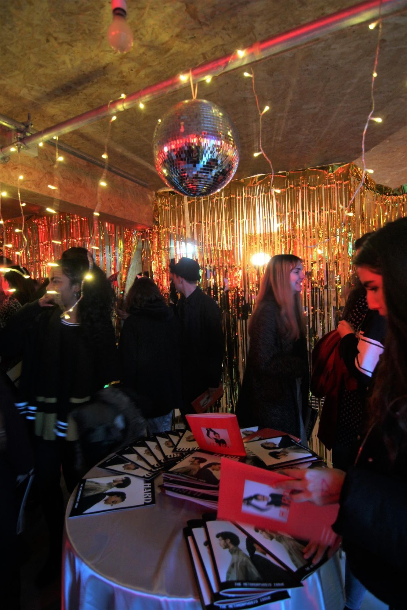 Image may contain: Bazaar, Shop, Market, Crowd, Bar Counter, Pub, Night Club, Club, Lighting, Person, Human, Night Life