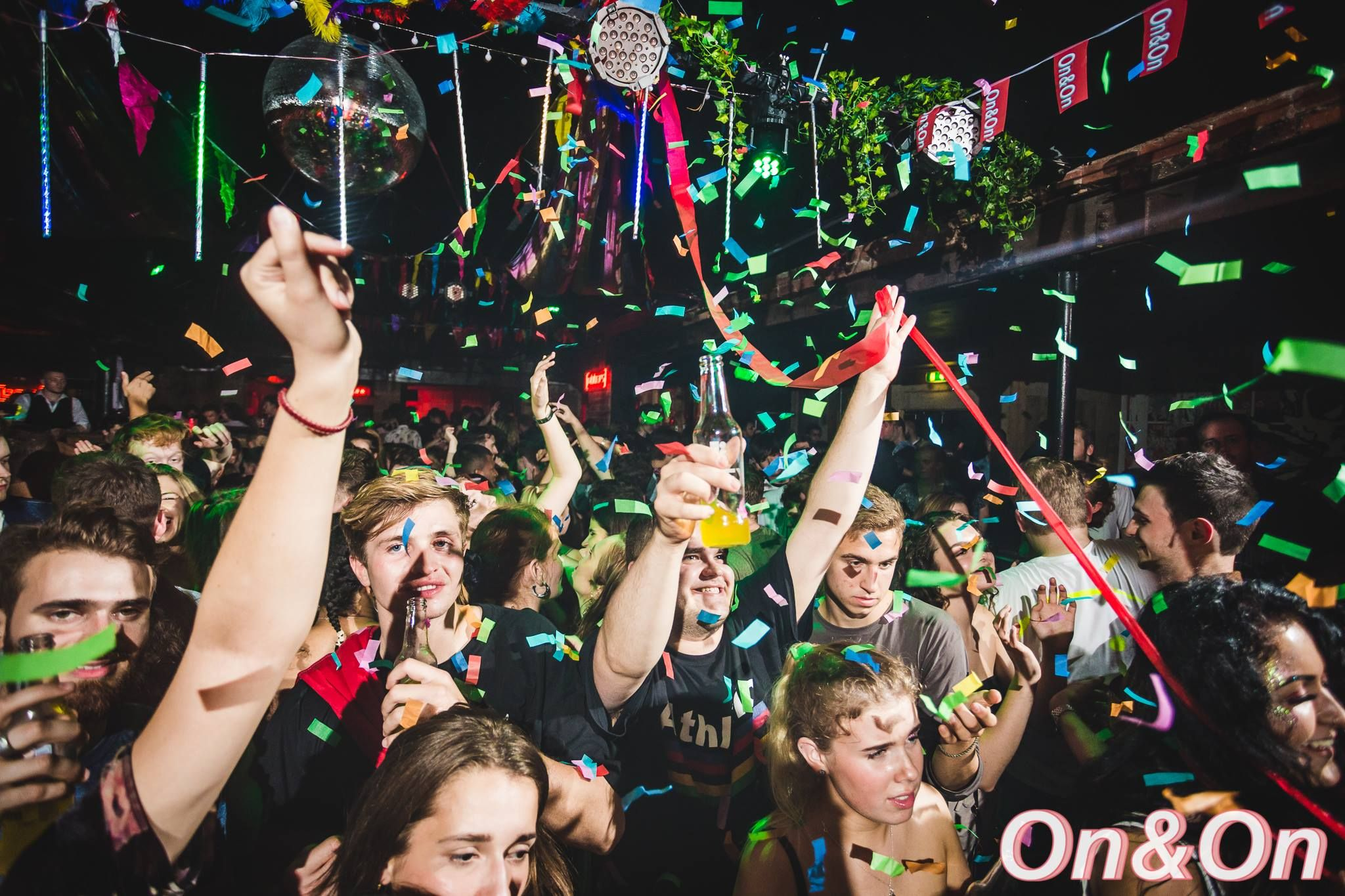 Image may contain: Crowd, Paper, Sunglasses, Accessories, Accessory, Night Life, Night Club, Club, Party, Human, Person