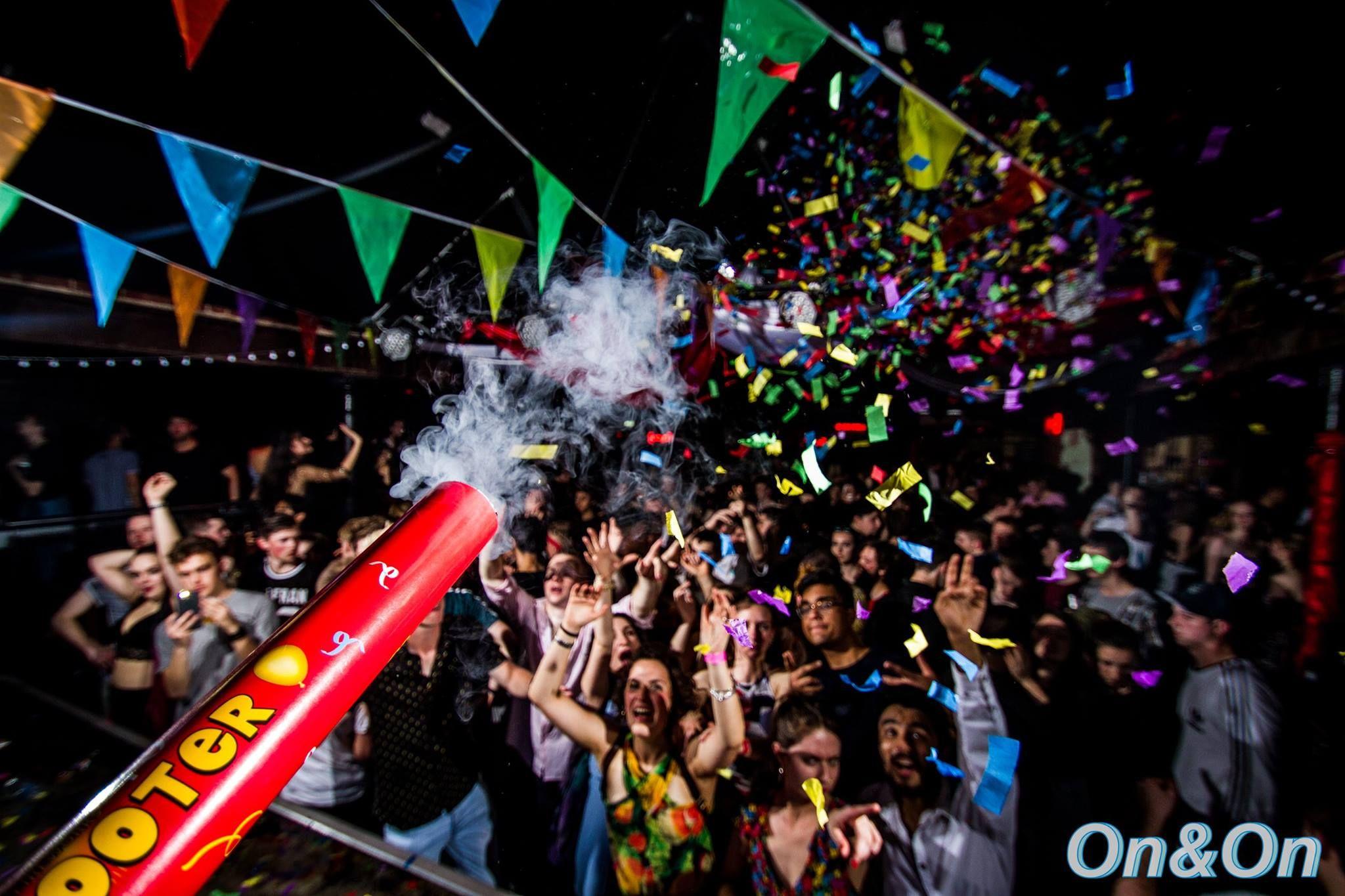 Image may contain: Festival, Club, Night Life, Crowd, Confetti, Paper, Human, Person