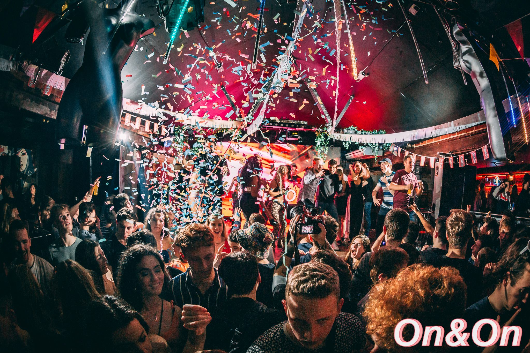 Image may contain: Festival, Confetti, Party, Paper, Night Club, Crowd, Club, Human, Person