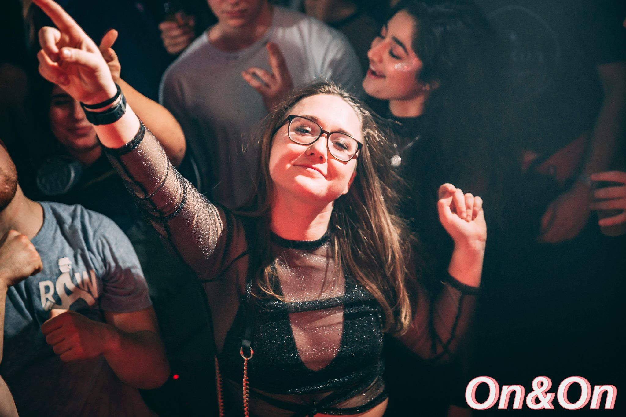 Image may contain: Leisure Activities, Finger, Party, Night Club, Club, Skin, Night Life, Accessory, Glasses, Accessories, Person, Human