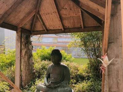 Image may contain: Building, Buddha, Art, Worship, Person, Human