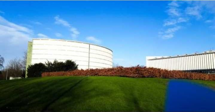 Image may contain: Convention Center, Lawn, Office Building, Building, Architecture, Planetarium, Plant, Grass