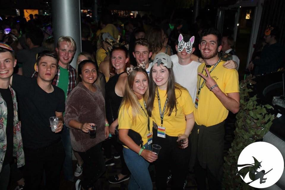 Image may contain: Pub, Bar Counter, Hat, Crowd, People, Night Club, Face, Club, Costume, Night Life, Apparel, Clothing, Party, Human, Person