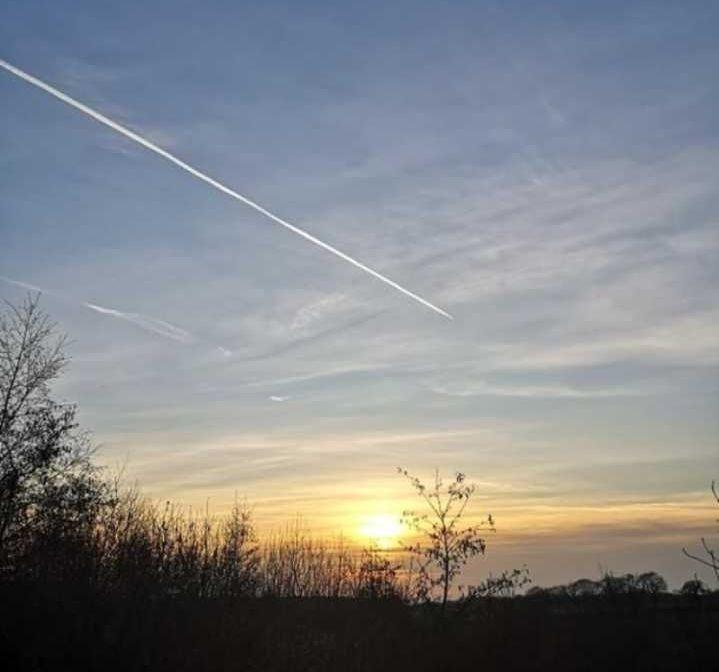 Image may contain: Sunlight, Dusk, Red Sky, Sunset, Dawn, Utility Pole, Sunrise, Sun, Sky, Outdoors, Nature