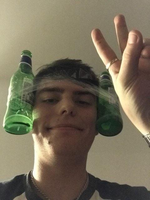 Image may contain: Pop Bottle, Beer Bottle, Finger, Head, Alcohol, Beer, Beverage, Drink, Bottle, Person, Human
