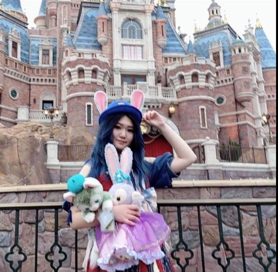 Image may contain: Amusement Park, Theme Park, Girl, Woman, Photography, Portrait, Photo, Dress, Face, Fort, Human, Person, Female, Vacation, Clothing, Apparel, Castle, Palace, Architecture, Mansion, House, Building, Housing, Costume