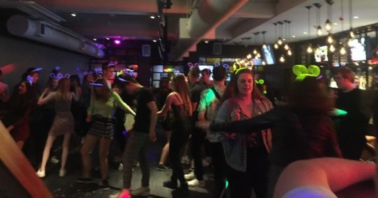 Image may contain: Party, Disco, Lighting, Night Life, Footwear, Apparel, Shoe, Clothing, Night Club, Club, Person, Human
