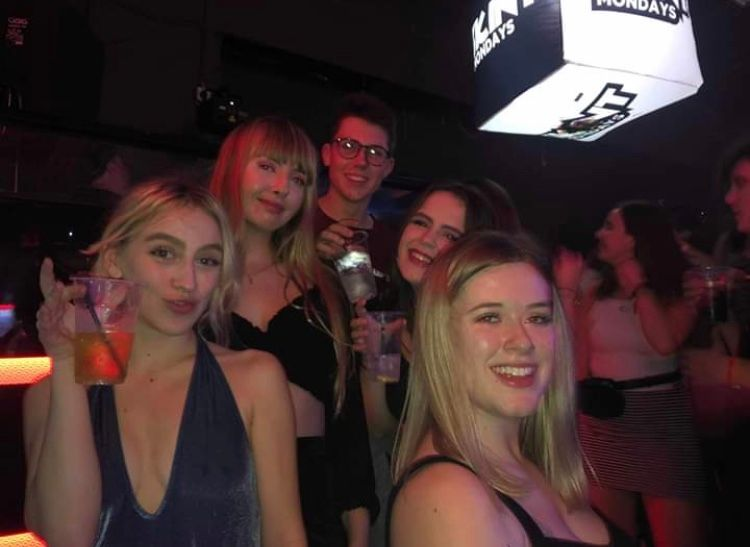 Image may contain: Face, Disco, Night Life, Night Club, Club, Party, Human, Person