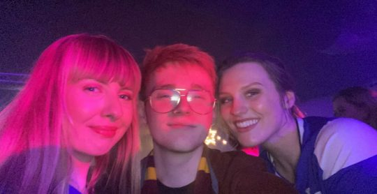 Image may contain: Teeth, Lip, Mouth, Purple, Kid, Girl, Woman, Child, Teen, Blonde, Night Life, Selfie, Lighting, Smile, Photography, Photo, Portrait, Head, Female, Face, Person, Human, Accessories, Glasses, Accessory