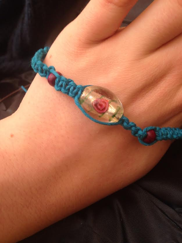 Never mind that scruffy bit of ribbon try having a handmade one of a kind festival band .