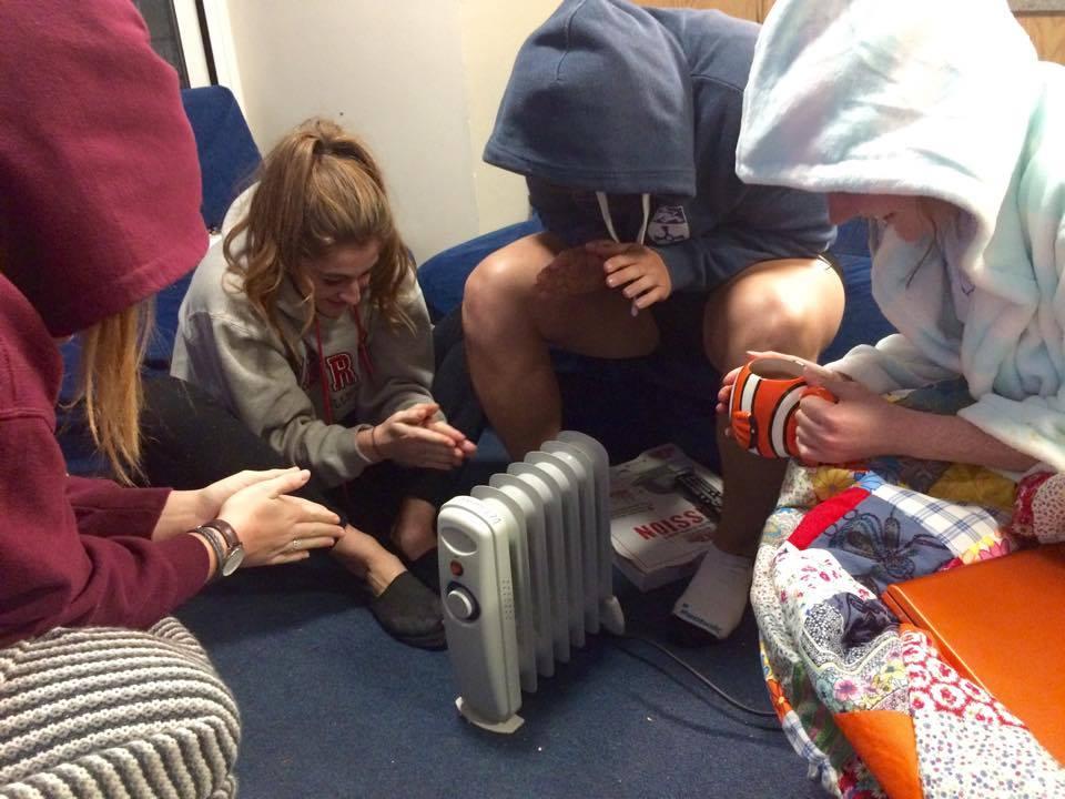 Huddling for warmth, Rachel, Tass, Ed, and Chloe.