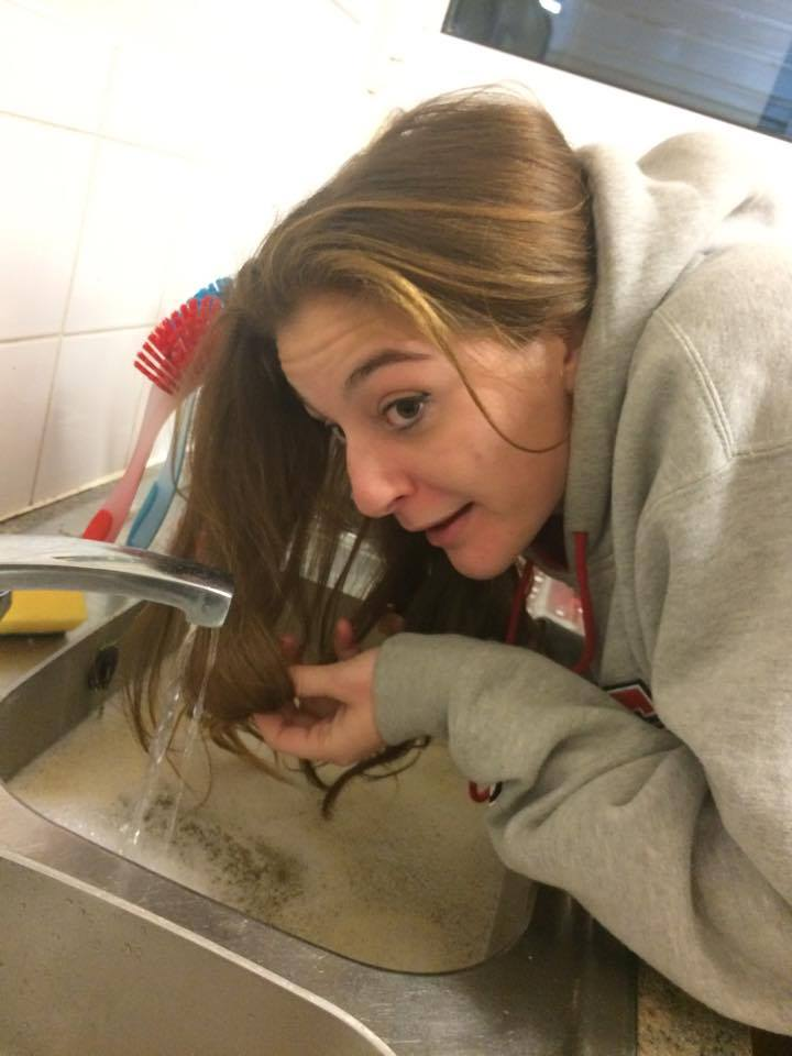 Tass, 21, is close to washing her hair with kettle water in the sink.