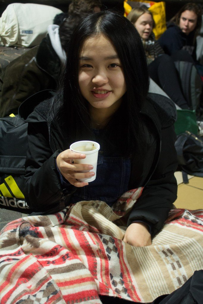 Xin Wen, 18, is a foreign student from China. She warmed herself up with a cup of coffee as the long night began.