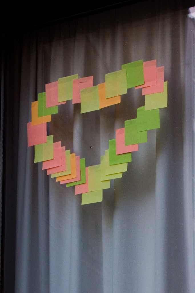 A love heart presented in multicoloured Post-It notes.
